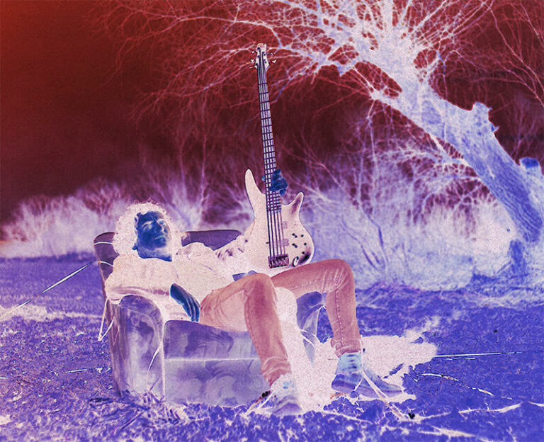 Psychedelic image featuring a guy lying in a couch with a guitar in the middle of the forest